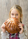 Girl eating a bun little cute Stock Photos