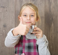 Girl eating candy little a chocolate Royalty Free Stock Photography