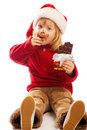 Girl eating chocolate Royalty Free Stock Images