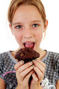 Girl is eating chocolate cupcake Stock Images