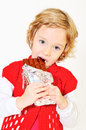 Girl eating chocolate little pretty big bar Stock Photography