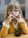 Girl eating cookie Royalty Free Stock Photos