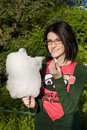 Girl eating cotton candy Stock Images