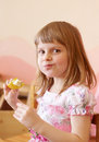 Girl eating fruit eats a piece of from sticks Stock Photo