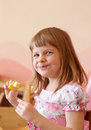 Girl eating fruit eats a piece of from sticks Royalty Free Stock Photos