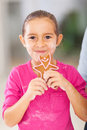 Girl eating gingerbread cookie beautiful little she and parent just baked Stock Photo