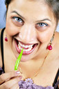 Girl eating green chilly Royalty Free Stock Image