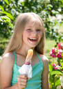 Girl eating ice-cream Stock Photo