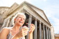 Girl eating ice cream by pantheon rome italy happy tourist woman laughing enjoying italian gelato while sightseeing Royalty Free Stock Image