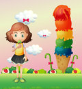A girl eating an icecream beside a giant icecream illustration of Royalty Free Stock Photo