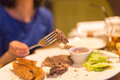 Girl eating meat with salad in a restaurant Royalty Free Stock Photo
