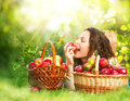 Girl Eating Organic Apple in the Orchard Royalty Free Stock Photo