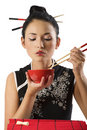 Girl eating oriental food Royalty Free Stock Photo