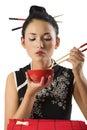 Girl eating oriental food Royalty Free Stock Photo
