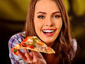 Girl eating piece of pizza Royalty Free Stock Photo