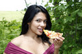 Girl eating pizza Stock Image