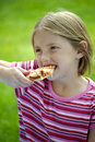 Girl Eating Pizza Royalty Free Stock Images