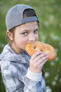 Girl eating pretzel Royalty Free Stock Photo