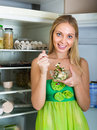 Girl eating salad from fridge hungry young woman near opening Royalty Free Stock Photography