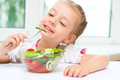 Girl eating salad Royalty Free Stock Photo