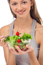 Girl eating salad sitting on her bed Royalty Free Stock Image