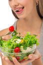Girl eating salad sitting on her bed Royalty Free Stock Photos