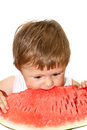 Girl eating a slice of watermelon Royalty Free Stock Photos