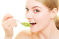 Girl eating slices of kiwi fruit. Healthy diet. Royalty Free Stock Photo