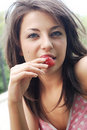 Girl eating a strawberry Royalty Free Stock Photos