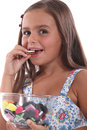 Girl eating sweets Stock Photo