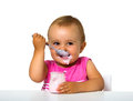 Girl eating yogurt isolated on white Royalty Free Stock Photography