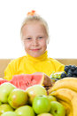 Girl eats fruit Stock Image