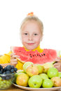 Girl eats fruit Stock Images