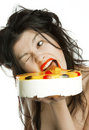 Girl eats fruit cake Royalty Free Stock Photography