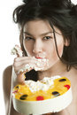 Girl eats fruit cake Royalty Free Stock Photos