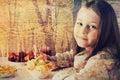 Girl eats fruit dessert little in cafe Stock Photo
