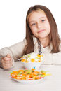 Girl eats fruit dessert spoon on a white background isolated Royalty Free Stock Image