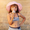Girl eats ice cream Stock Image