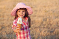 Girl eats ice cream portrait of in a pink hat who Stock Images