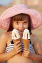 Girl eats ice cream portrait of in a pink hat who Royalty Free Stock Photo