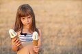 Girl eats ice cream portrait of in a pink hat who Stock Photo