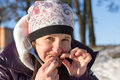 Girl eats kebab outdoors in winter Royalty Free Stock Photo