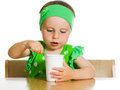 Girl eats with a spoon dairy product. Stock Photography