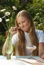 The girl eats  yogurt Royalty Free Stock Photo