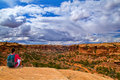 Girl on the edge hiking sittin of cliff elephant hill canyonlands needles district utah Stock Photos