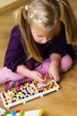 Girl with educational pin puzzle toy Royalty Free Stock Photo