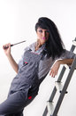 Girl electrician a young in a overall with screwdriver Royalty Free Stock Photo