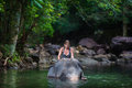 The girl with the elephant in the water Royalty Free Stock Photo