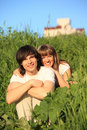 Girl embraces guy behind for shoulders Royalty Free Stock Photo