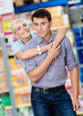 Girl embraces man in the market men concept of happy relationship and affection Royalty Free Stock Photo